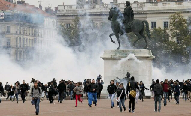 Protesters scatter as police shoot tear gas into a crowd