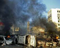 Protesters set fire to cars in Beirut.