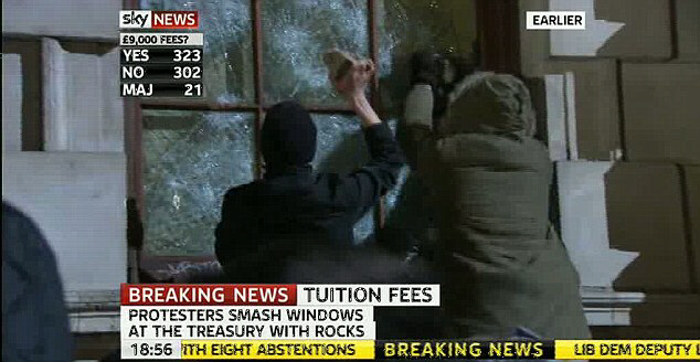 Protesters smashed at the windows of the Treasury building