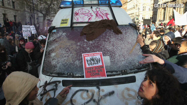 Protesting students attack police van