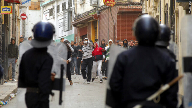 Protestors clash with riot police on January 7, 2011 in central Oran, 430 kilometres (270 miles) west of Algiers