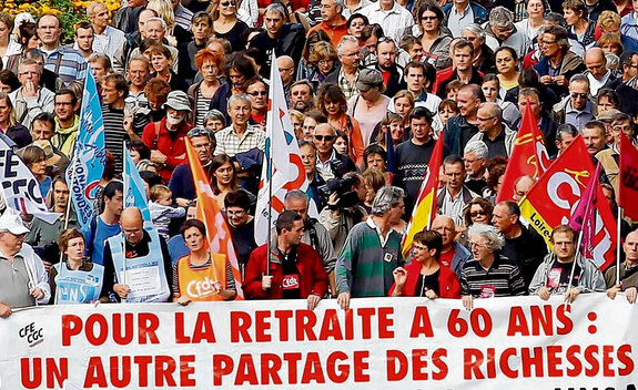 "Protesters demonstrate in Nantes over proposed pension changes. The banner reads: ""For retirement at 60: a different sharing of wealth"". Photograph: Reuters"