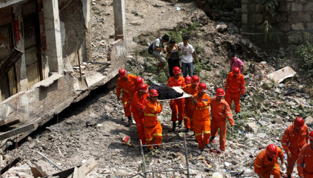 Rescuers remove a body of a victim in SW China