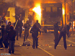 Residents of Villiers-le-Bel torch vehicles and throw stones at riot police