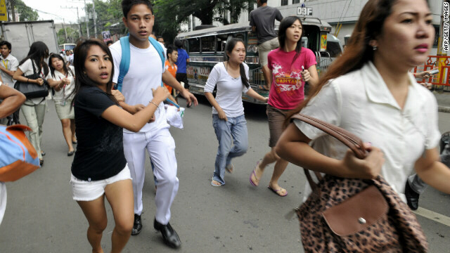 Residents scamper to safety after a 6.8 earthquake hit near Cebu City.