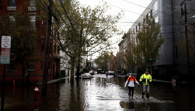 Residents traverse flooded streets of Hoboken