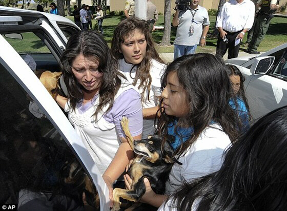 Reyna Marisol Chicas and other cult members are led away by police for evaluation