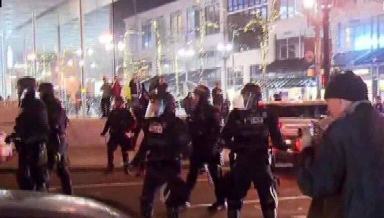 Riot police are called out to deal with anti-Trump mobs