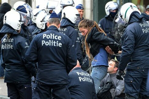 Riot police detain protesters in Brussels