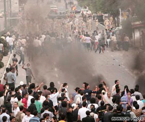 Riot police fire tear gas at protesters in Tehran