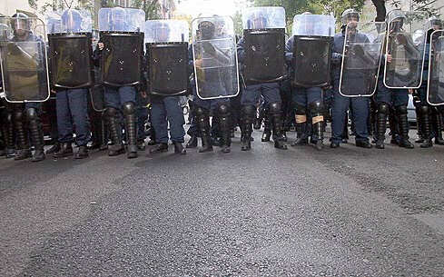 Riot police form a blockade Monday in downtown Budapest