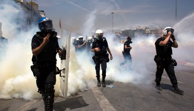 Riot police use water cannons and tear gas