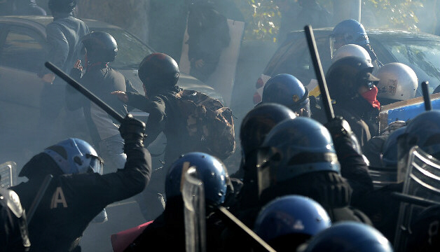 Riot policemen fight demonstrators in Rome