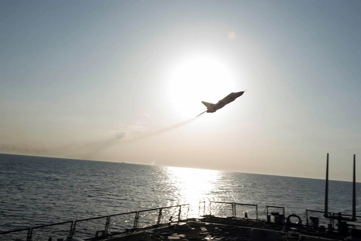 Russian Sukhoi Su-24 attack aircraft makes low pass by USS Donald Cook