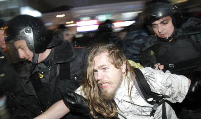 Russian police detain a man at an opposition protest in central Moscow - December 5, 2011