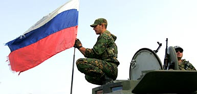 Russian soldiers adjust Russian flag in South Ossetia