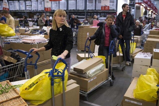 Russians wait in line to pay for their purchases at the IKEA store