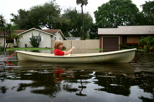 Ryan Rodriguez, 10, canoes in his Florida neigborhood