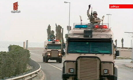 Saudi troops cross the causeway leading to to Bahrain
