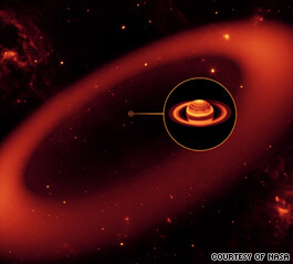 NASA's Spitzer Space Telescope has spotted a massive, nearly invisible ring around Saturn.