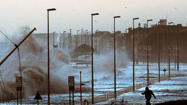 Sea water swamps coastal roads near Blackpool