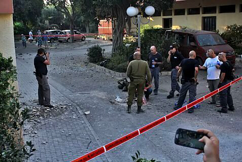 Security forces examine site of missile attack on Kibbutz HaZiv