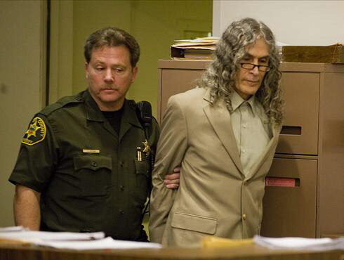 Serial killer Rodney James Alcala, right, is escorted into the courtroom