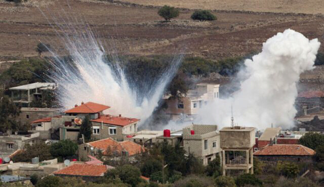 Smoke rises after shells fired by Syrian army explode in Israeli town