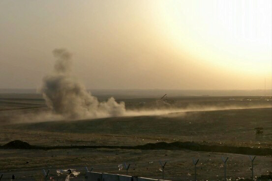 Smoke rises from airstrikes targeting IS militants outside city of Erbil in northern Iraq