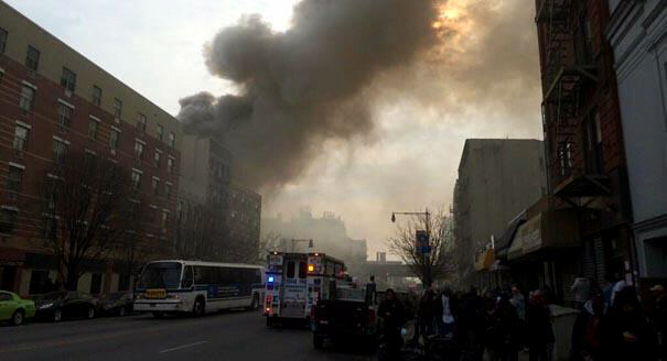 Smoke rises from the site of an explosion and building collapse at Park Avenue in Manhattan