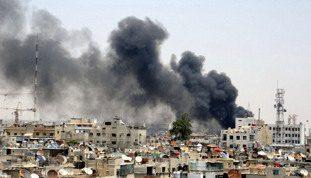 Smokes rises after an explosion in central Damascus