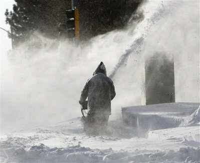 Snow drifts reach 15 ft in central US