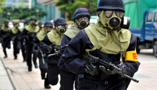 South Korean police in gas masks take part in a drill