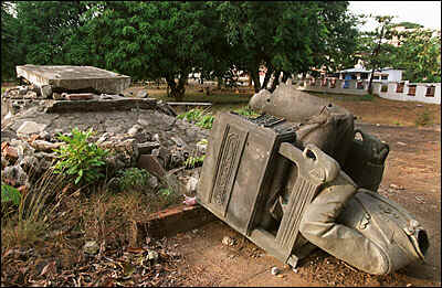 The statue of the great man is toppled