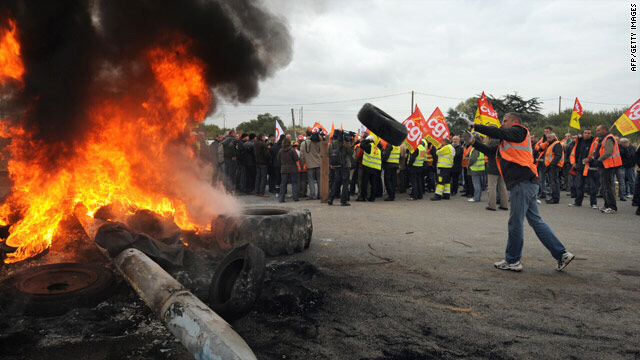 Striking workers burn tires at an oil refinery in Saint-Nazaire