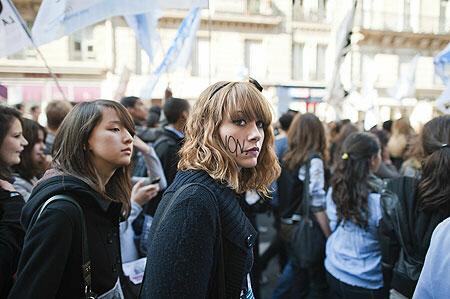 "French students, one with ""No to the reform"" written on her face, demonstrate Saturday in Paris"