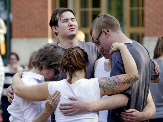 Students and faculty pray together following shooting on campus of Seattle Pacific University