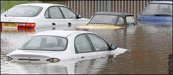 Submerged cars after Severn and Avon burst their banks in Tewkesbury