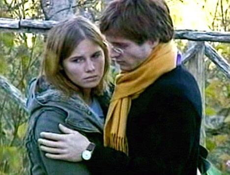 This photo taken Friday Nov. 2, 2007 shows Amanda Marie Knox, left, and Raffaele Sollecito, looking on outside the rented house where 21-year-old British student Meredith Kercher was found dead, in Perugia, Italy. Knox's parents said in an interview broadcast Friday Feb. 1, 2008 that their daughter who is accused of the Kercher slaying, could never have committed such a crime. (Stefano Medici/AP Photo)