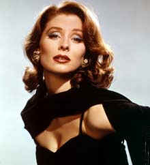 Suzy Parker, shown in this 1965 photo, was known for her red hair and ideal bone structure
