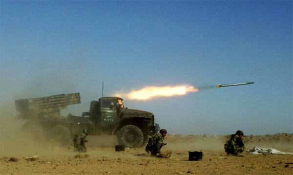Syrian armed forces fire a missile during a live ammunitions exercise