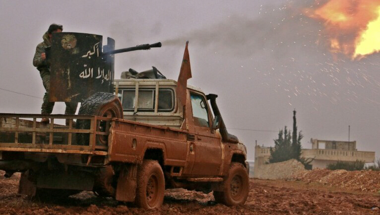 Syrian opposition fighters fire towards positions held by Islamic State group