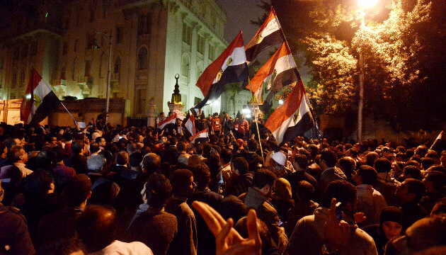 Tens of thousands of demonstrators encircled the presidential palace in Cairo