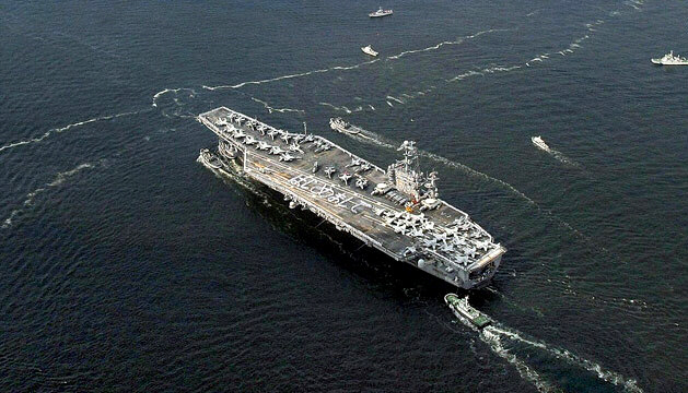 A carrier strike group led by the USS George Washington heads for the Yellow Sea