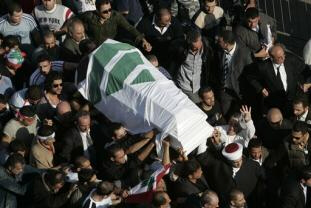 The coffin of Lebanese politician Pierre Gemayel is carried by family