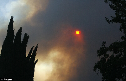 The sun is turned red by smoke and fire in California