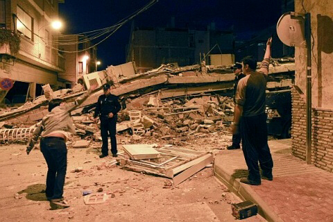 Tons of rubble from collapsed buildings are seen in Lorca, Spain
