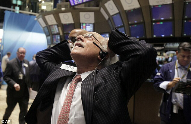 Trader Peter Tuchman works the floor of New York Stock Exchange