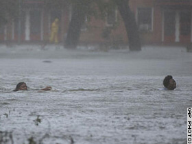 Two women swim for higher ground in New Orleans