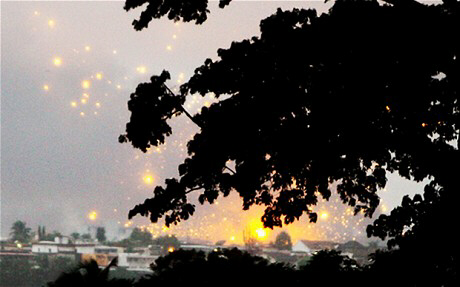 UN air strikes are seen behind a tree in Abidjan Photo: REUTERS